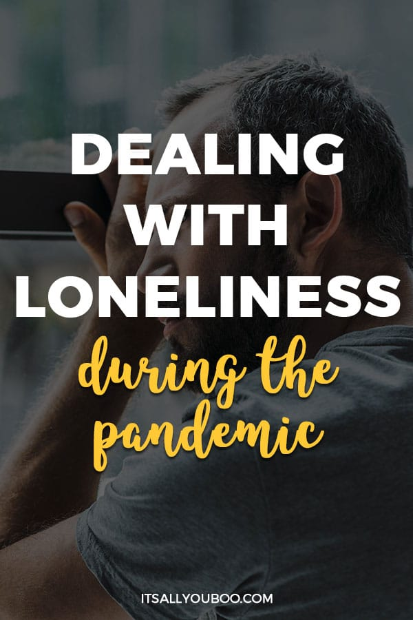 a man leaning on a window with Dealing with Loneliness during the Pandemic written
